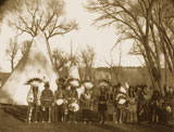 Southern Ute Chief Charley Buck, nicknamed Buckskin Charley, is the 5th from the left; Chief Severo (1844-1913), leader of the Capote Ute band, is 6th from the left; Charley's wife, Emma Buck, is 8th from the left.