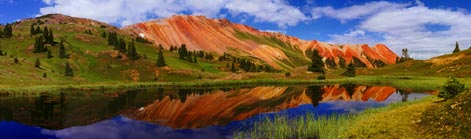 The San Juan Mountains are the heart of southwestern Colorado. Red Mountain gets its red, orange, and yellow-brown colors from the various iron oxides of which it is composed. Click to enlarge Red Mountain