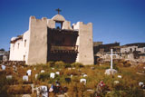 Located 40 miles southwest of Gallup on the Zuni Pueblo is Our Lady of Guadalupe Mission which was completed in 1680. The kachina murals inside the church are being restored by Dr. Alex Seowtewa. Click to enlarge Nuestra Senora de Guadalupe mission at Zuni